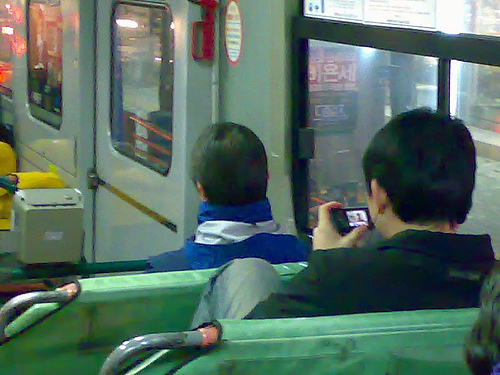 a person watching tv on his cellphone