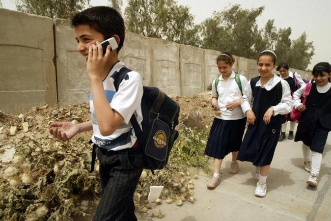 School boy using a cell phone