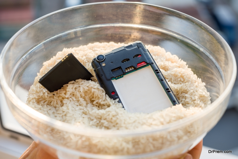 Feeding rice to a soaked phone