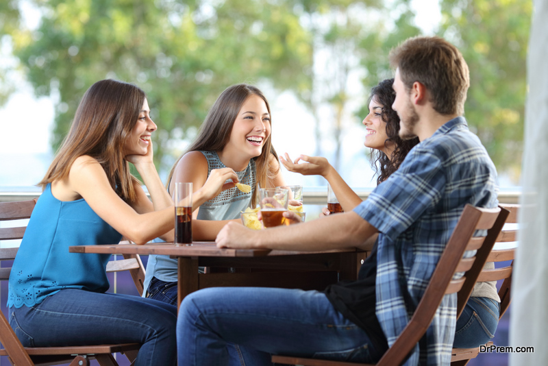 Group of friends talking and drinking